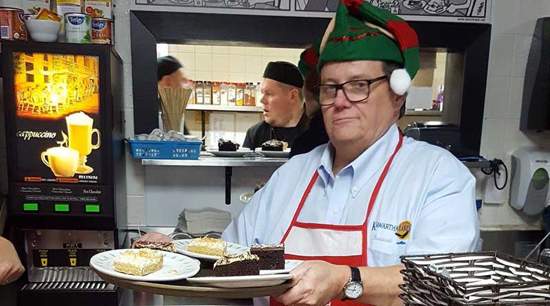 man in elf hat with tray of food