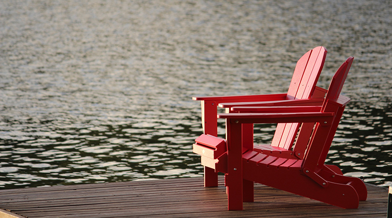 two red chairs on dock