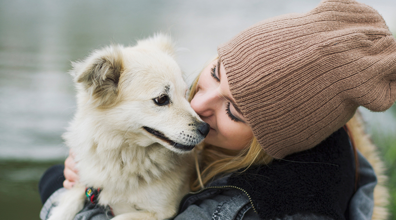 women hugging dog