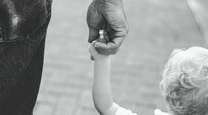 dad holding childs hand
