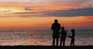 kids fishing with parent