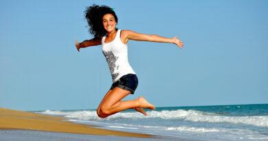 girl on beach jumping