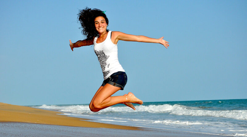 girl on beach jumping