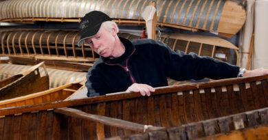 Dick surveying canoe in for repairs