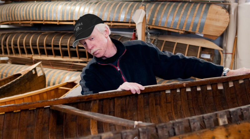Dick surveying canoe in for repairs