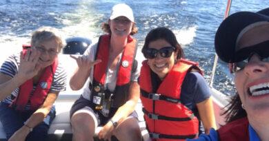 4 women in a boat