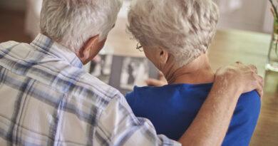 older couple looking through scrapbook